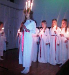 St Lucia with a halo of candles