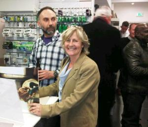 Jane Hilton signing one of her books at The Photographers Gallery